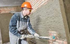Штукатурка стенки механизированным способом Петербурге